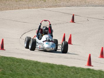 Rochester Institute of Technology's (RIT) all-female electrical vehicle driving on the track.