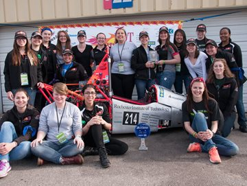 Hot Wheelz team with winning driver Phoebe displaying their trophies.